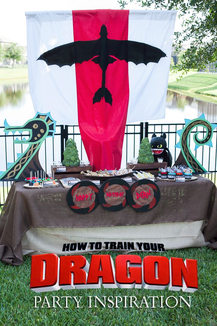 How to Train Your Dragon Birthday Party - Love this table setup, and the viking hat cupcakes are ADORABLE.