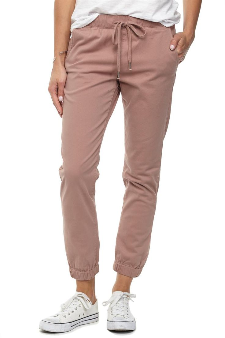 The Cuffed Chino is an elastic waisted slim fitting pant with hip pockets, draw…