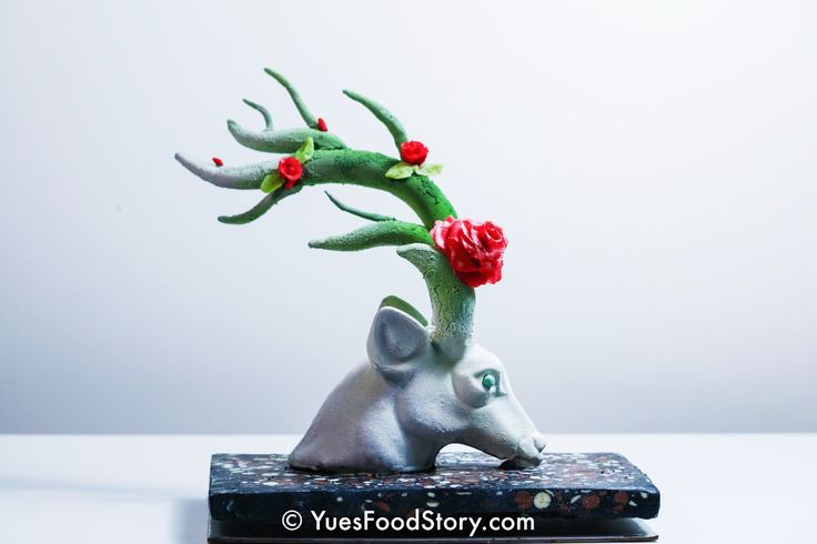 Christmas theme Chocolate showpiece sculpture created by Yue Zhang. Chocolate with marzipan roses, inspired by Harry Potter Patronus, Christmas reindeer and the sculpture from artist Ruilin Wang.