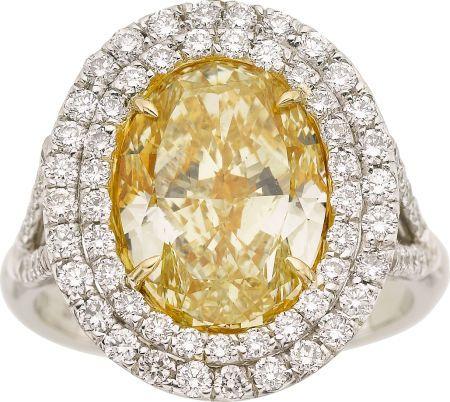 Fancy Intense Yellow Diamond and Platinum Ring