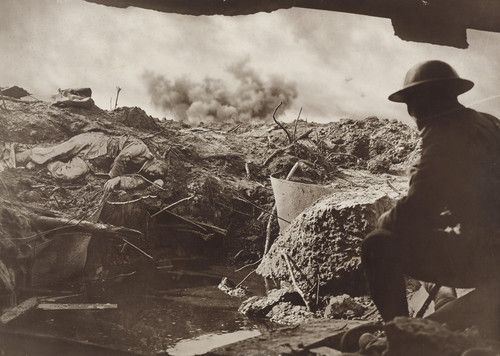 Looking out from the entrance of a captured Pill-Box on to the shell ravaged battlefield, 1917. Frank Hurley.