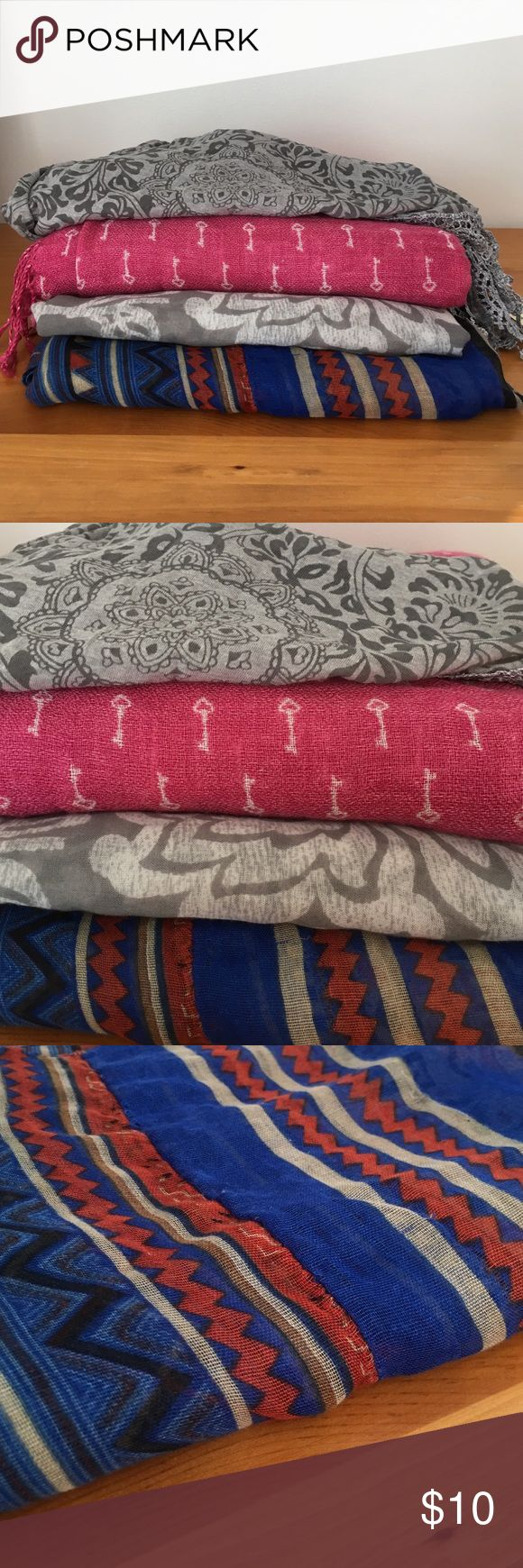 Scarf bundle - make an offer! Bundle of 4 lightweight scarves in various colors. Gray floral and blue Aztec scarves are infinity style, pink key scarf has tassels on the ends, gray kerchief-style scarf is NWT. All in good condition, Aztec scarf has a few pulls that are not extremely noticeable. Accessories Scarves & Wraps