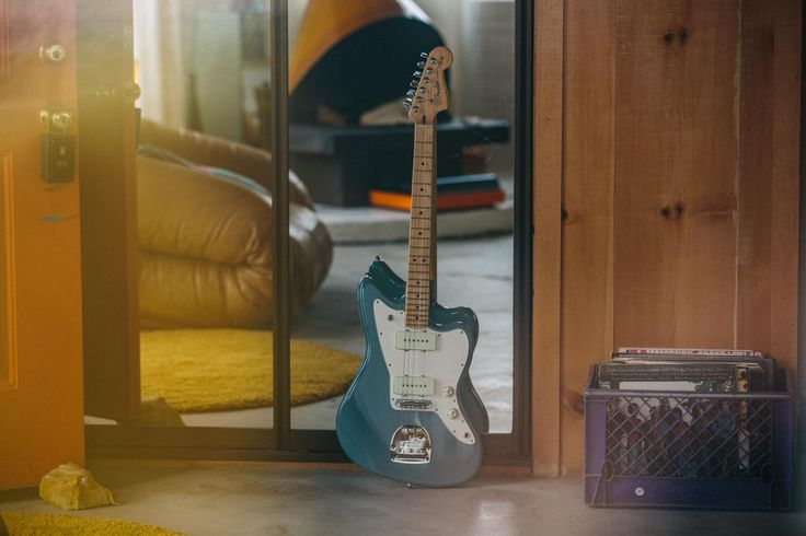 This #AmericanPro Jazz Master is trying on outfits, Sonic Gray seems like a good fit.   #Fender #AmericanProfessional #Guitar #Guitars #Home #Decor #Film #Photo #Music #Gray #Blue #Couch #Yellow #Records #Vinyl