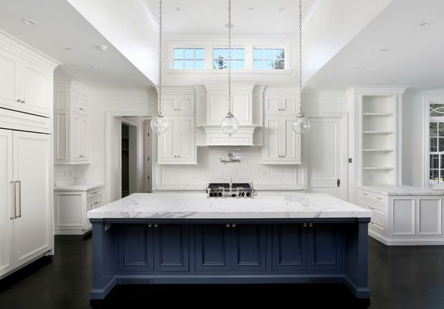White cabinetry with navy island