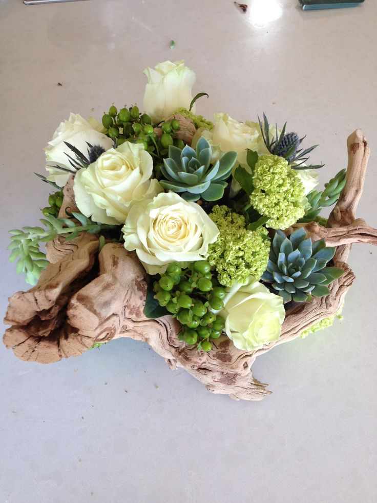 Driftwood floral arrangement I made for a friends wedding centerpiece with succulents