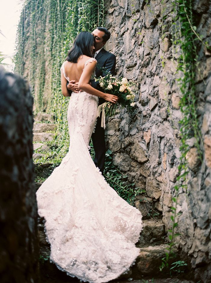 Romanting Vow Renewal in Bali with a Stunning Fitted Lace Wedding Dress
