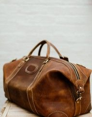 Brown / Tan color Genuine Leather Duffle Bag, Golden Luxury Zips. For the stylish and luxurious travel experience. -Long Adjustable Shoulder Strap -Solid Quality Hardware -Fabric Lining -Inner zipper pocket, laptop sleeve, one cell pocket, one purse pocket. Made out of superior cowhide leather, with a raw vintage look & feel. #leather #leathergoods #leatherwork #leathercraft #leatherbag SWISH & SWANK www.swish-swank.com