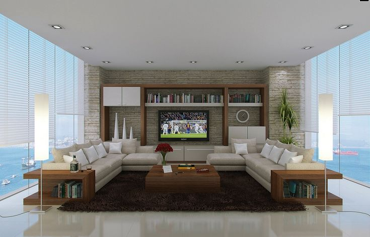 Neutral living room L shaped sofas + the Footy's on teli ;)
