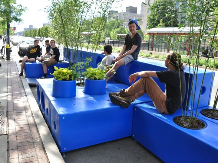 Not sure where you want a parklet, or if you want one at all? Make it modular and movable! These plastic blocks in Boston interlock in numerous ways to create custom spaces with minimal time and cost. Just add water and the structure becomes a heavy, solid curbside fixture. #Placemaking #LQC #Ultralight #Parklets