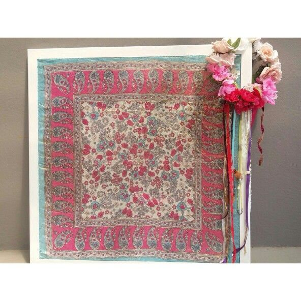 Use an old scarf and stretch it across a frame to create a new piece of art for your home