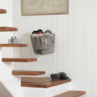 Stair basket mounted on the wall from Korbo