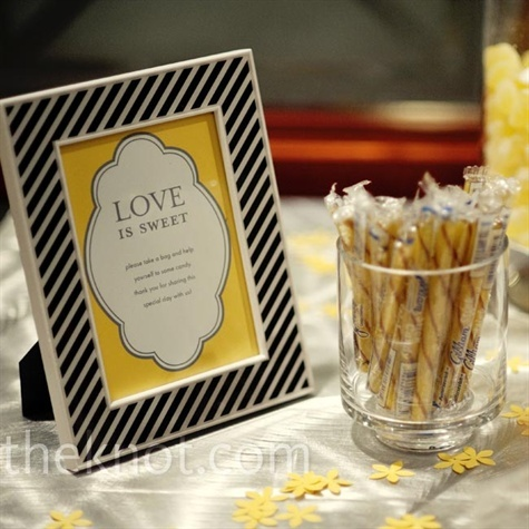 Datina created a DIY treat bar filled with yellow, white, and silver candies that she purchased in bulk.