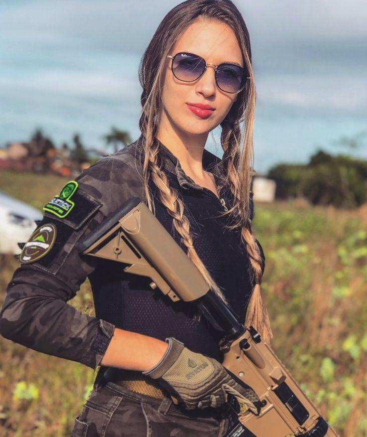 Shir ready to shoot. | Girl guns, Military girl, Curvy outfits