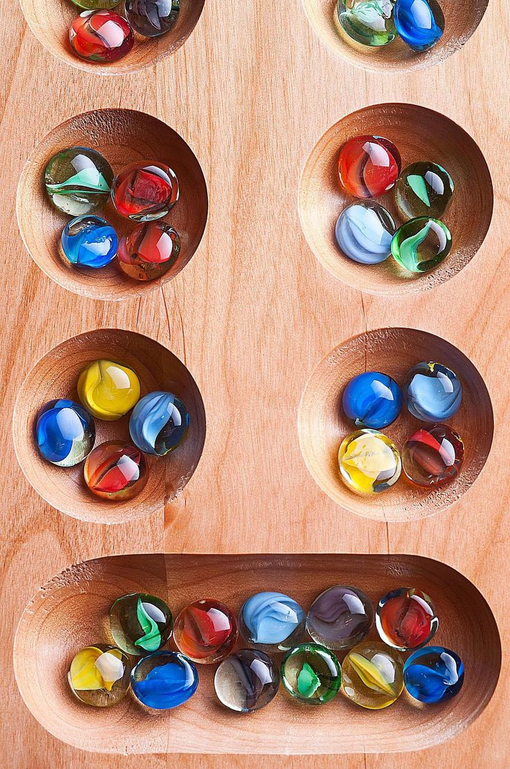 Learn the complete rules of the standard two-rank Mancala, an ancient board game.