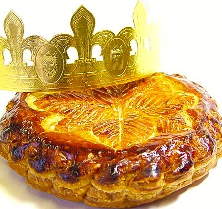 French tradition La galette des Rois served on the feast of Epiphany. Whoever finds the fava bean inserted in the cake before baking, will have to buy and serve one another day. This person will wear the crown for the time of the party.     Google Image Result for http://www.bonjourparis.com/static/img/fioritto/galette-des-roi-crown.jpg.