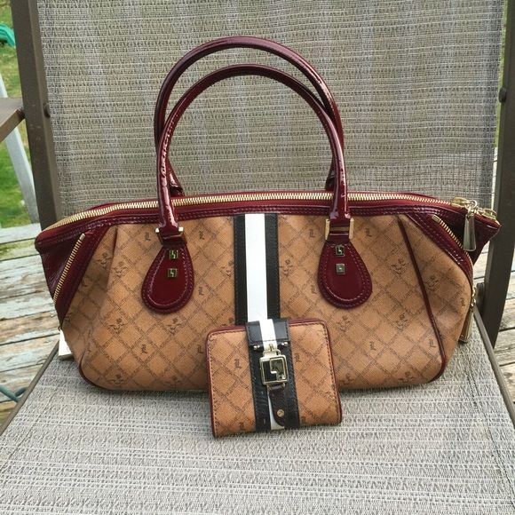L.A.M.B. Saddle Lipstick Esquivel&wallet bundle❤️ Preloved condition! ❤️esquivel satchel; Holiday 2007 Signature Lux Collection. Comes with dustbag. See pics I loved but good shape! Rare Description: Coated cotton canvas satchel with contrast patent leather trim. Doubleshoulder straps, striping detail down center. Goldtone hardware andlogo. Double top zip closure. Inside zip and additional pockets, lined.Protective metal feet. 5 1/2' drop from shoulder. Size: 14 x 6.5 x 7.5 in L.A.M.B. Bags