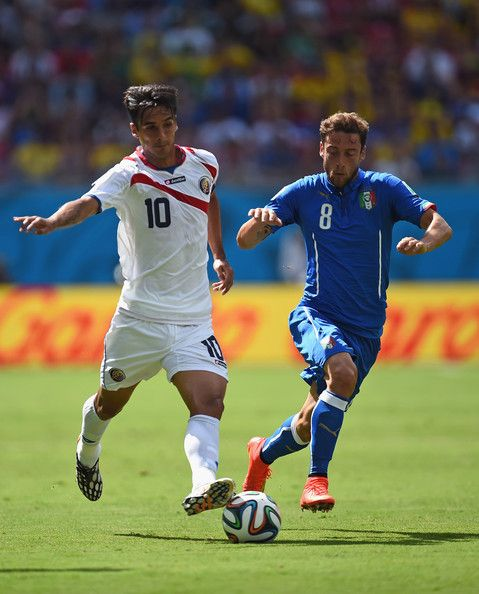 Bryan Ruiz of Costa Rica takes on Claudio Marchisio of Italy during the 2014 FIFA World Cup Brazil Group D match between Italy and Costa Ric...