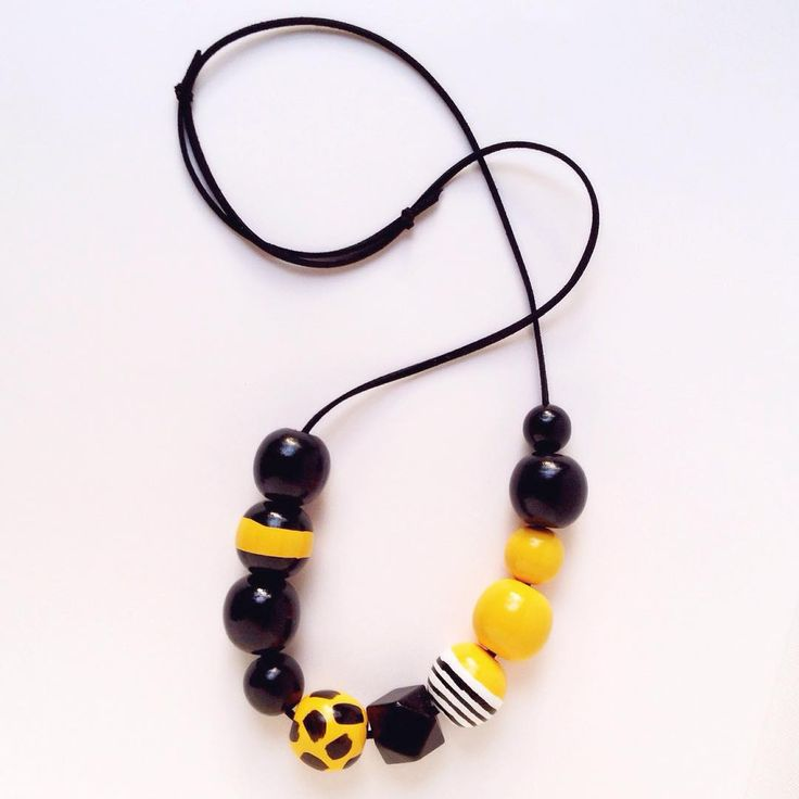 "You know your the Queen now show it with the ""Queen Bee"" necklace. Now up in the store - thecolorfulnest.etsy.com #etsy #etsyseller #woodbeads #woodjewelry #woodbeadnecklace #yellow #black #statementnecklace #sobold"