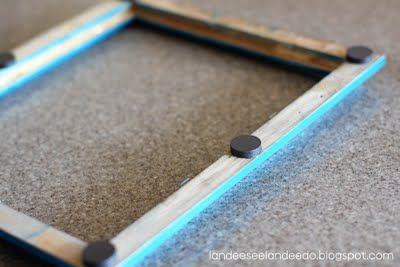 magnets glued to the back of wooden frames = immediately frame kid artwork on a fridge or magnetic board!