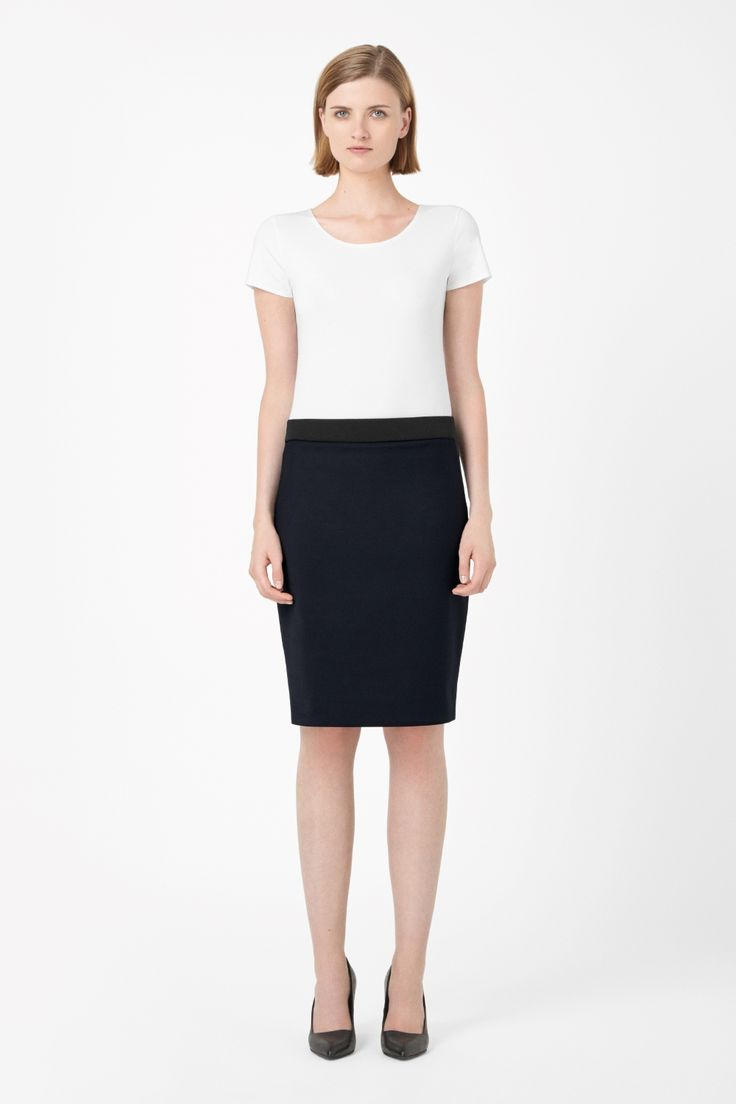 A slip-on style, this pencil skirt is made from stretchy cotton-mix for a comfortable close fit. Designed to sit just below the waist, this easy-to-wear style has minimal detailing and a contrast elasticated waistband.
