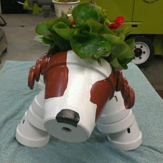 A terra cotta version of my friends dacshund....  so very creative of her.  She amazes me!
