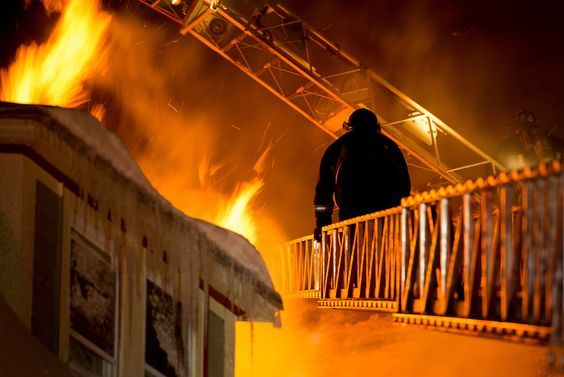 3 ALARMS BOX 3311,MATHER ST DORCHESTER.BOSTON FIREFIGHTER FROM LADDER 29, DESCENDS AERIAL AFTER HEAVY FIRE VENTS FROM THE ROOF.