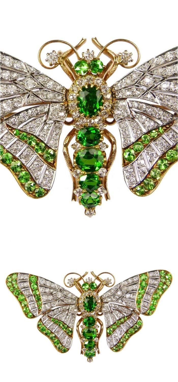 "Antique demantoid garnet and diamond tremblant butterfly brooch, c.1900, the ""en tremblant"" wings with pierced diamond set 'veining' and two lines of small circular cut demantoid garnets."