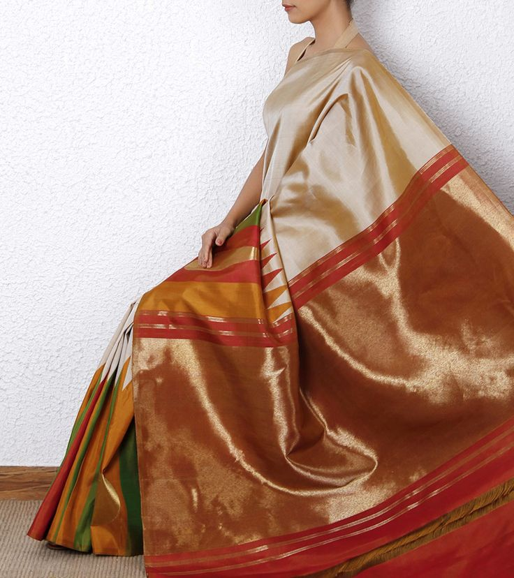 Beige Kanjivaram Saree with Zari work 1. My, that giant rectangle of gold on the pallu is ostentatious. I want one. 2. I like the crossover between traditional weaving motifs and modernist simplicity