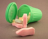 remember these little plastic green trashcans with sugar candy inside in the shape of garbage ?