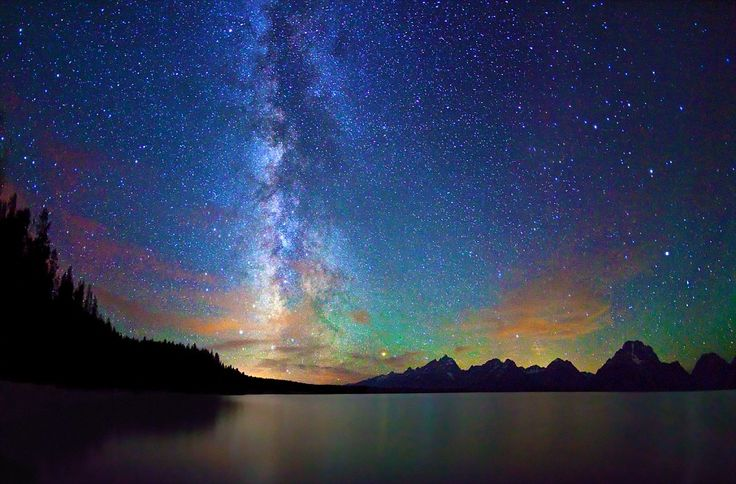 The Milky Way over Jackson Lake and Tetons at Grand Teton National Park on August 23, 2011 in Wyoming