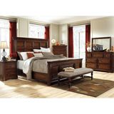 Ashley Leximore King/Cal King/Queen Panel HBD BDRM Set - Rich with traditional style and beauty, the classic design of the Leximore bedroom collection features select Mahogany and Acacia veneers covered in a rich dark brown finish that beautifully accents the heavy moulding and stunning framed details to capture a sophisticated look perfect for any decor.