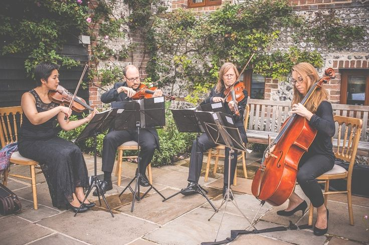 String quartet in the Court Yard at Upwaltham Barns