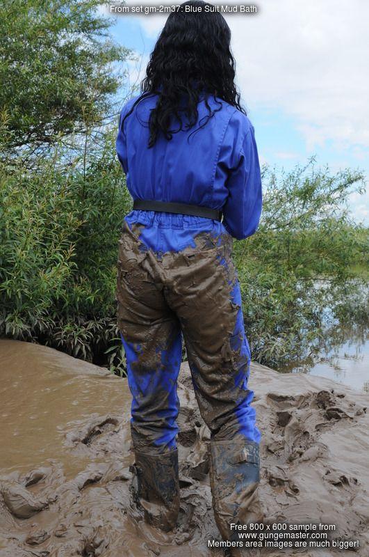 Blue rain suit in mud