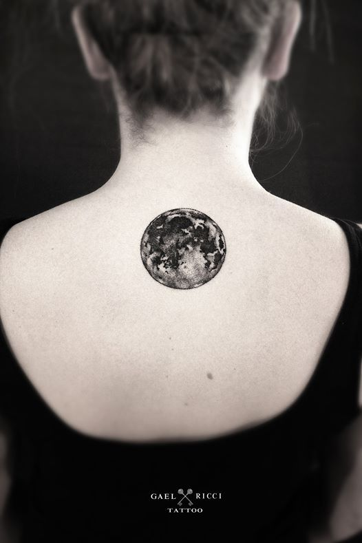 Just an AWESOME back tattoo of a very beautiful and realistic Moon with deep grey shades.