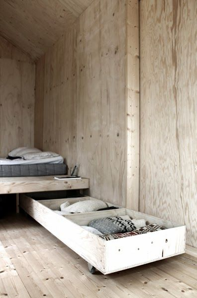 could custom make a roll-out bed that doubles as storage // A beautiful basic weekend cabin