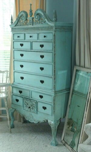 This antique piece is painted a delicious shade of turquoise, and it's detailed wood work is highlighted by the vibrancy of the blue. Freckles Boutiqe twosmallredheads.etsy.com