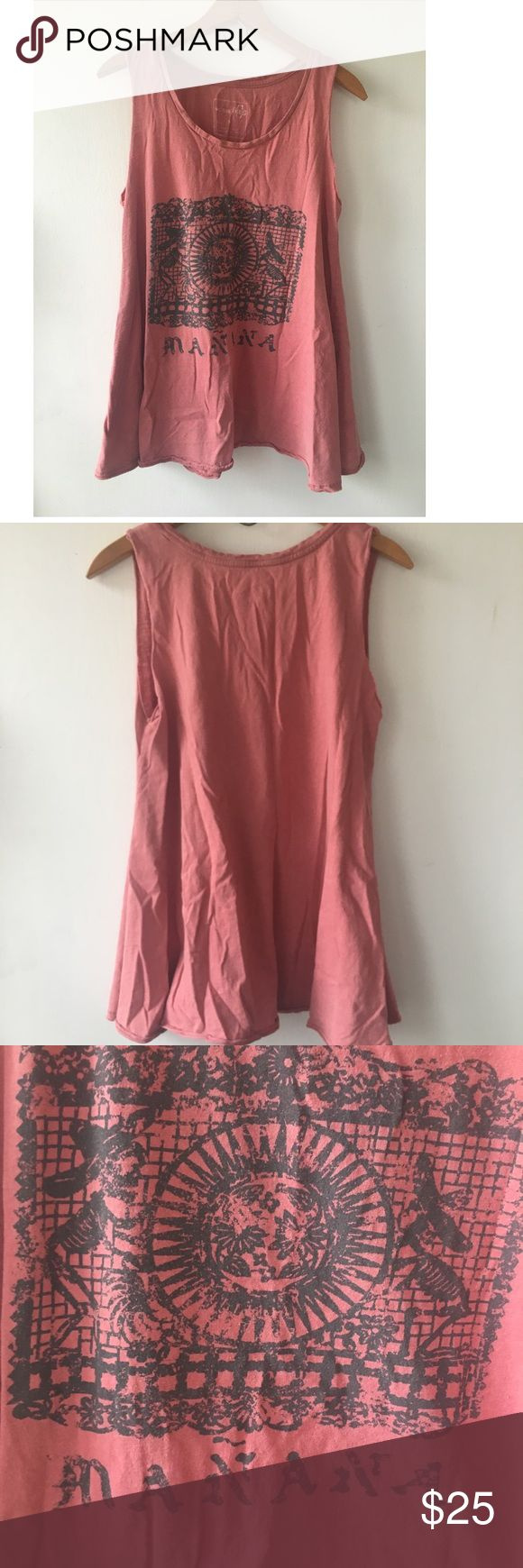 """We The Free Free People Mañana Graphic Tank Top We The Free by Free People loose-fitting tank top in a size medium. It's about 27"""" long and about 18"""" from one underarm to the other. It's in great shape, the edges on the sleeves are raw in the way they're cut but that's intentional. Made of 100% cotton and says """"Mañana (Spanish for 'tomorrow') on the front.   Offers: ✅ Trades: ❌ Free People Tops Muscle Tees"""