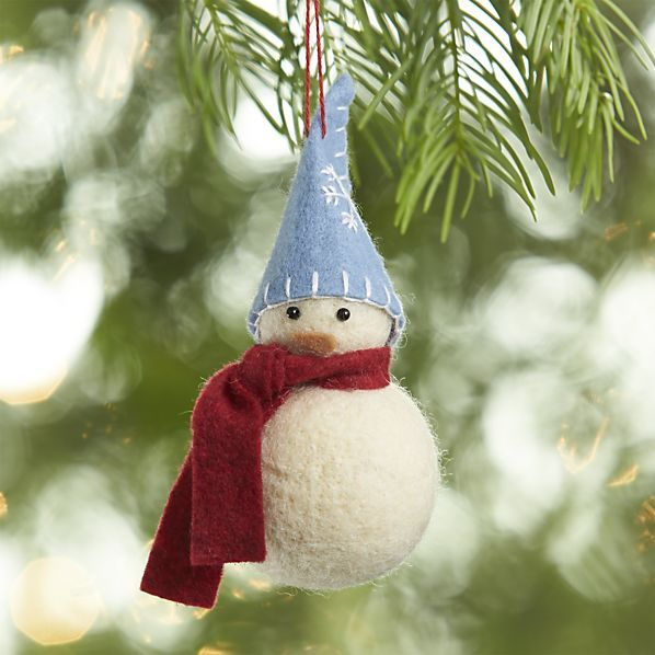Plump snowman bundles up tight in a muffler and stocking cap, handcrafted of wool felt.