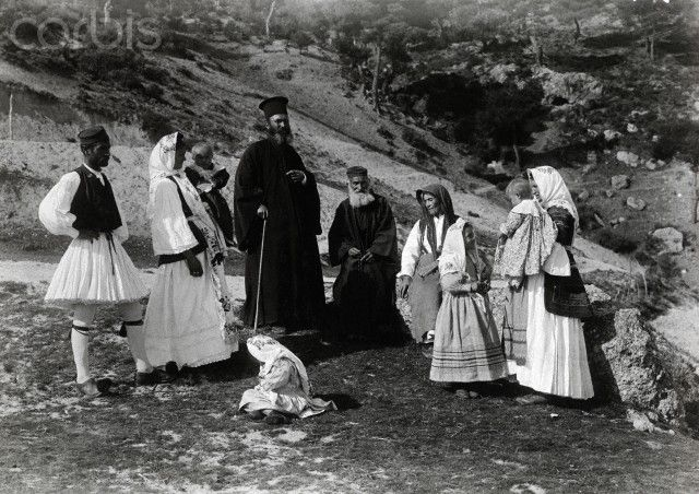 Greek parish priests and their families rest in a field-Fred Boissonnas