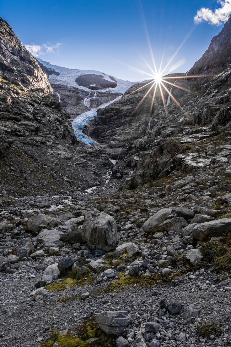 Kjenndalsbreen is a glacier in the municipality of Stryn in Sogn og Fjordane, Norway. It is a side branch of the Jostedalsbreen glacier, and is included in the Jostedalsbreen National Park