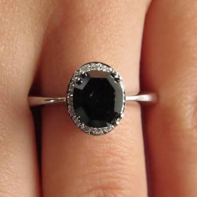 Instead of getting another ring to clunk up my fingers, I think I'd prefer to modify my black diamond engagement ring with a halo of white diamonds instead.