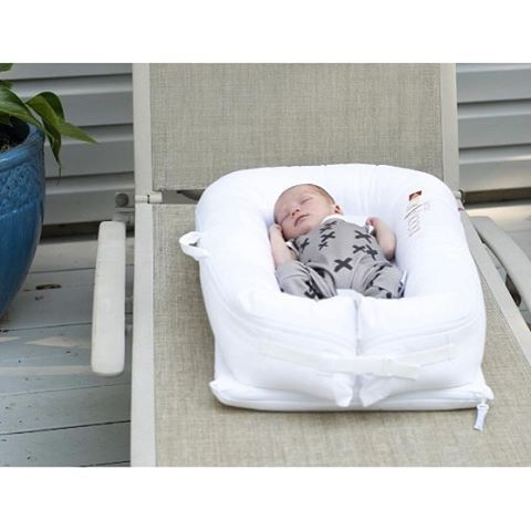 Family travel must have: DockATot portable baby bed and baby lounger. It's the best gear for family travel to keep little ones safe and comfy wherever you are. Visit dockatot.com for more info and to buy this must have new mom essential.