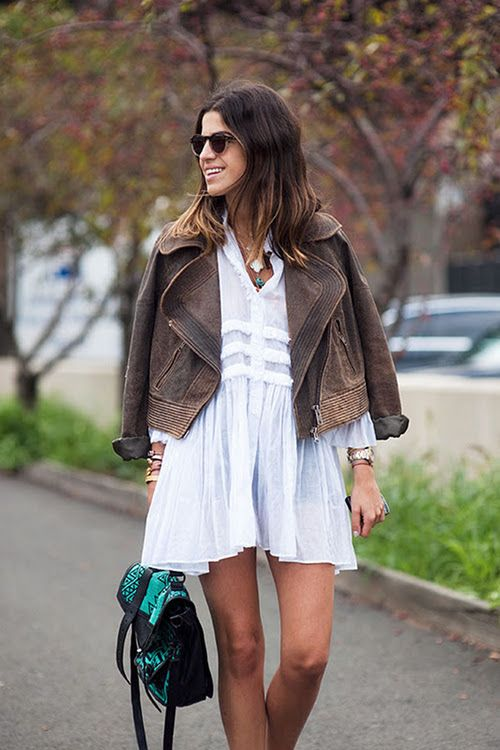 Leandra Medine in a white dress and brown leather jacket