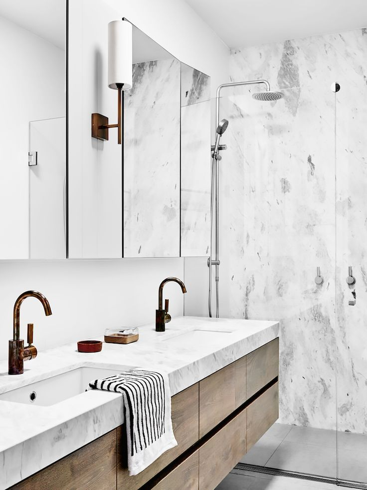 Modern bathroom with a marble shower, and a floating double sink