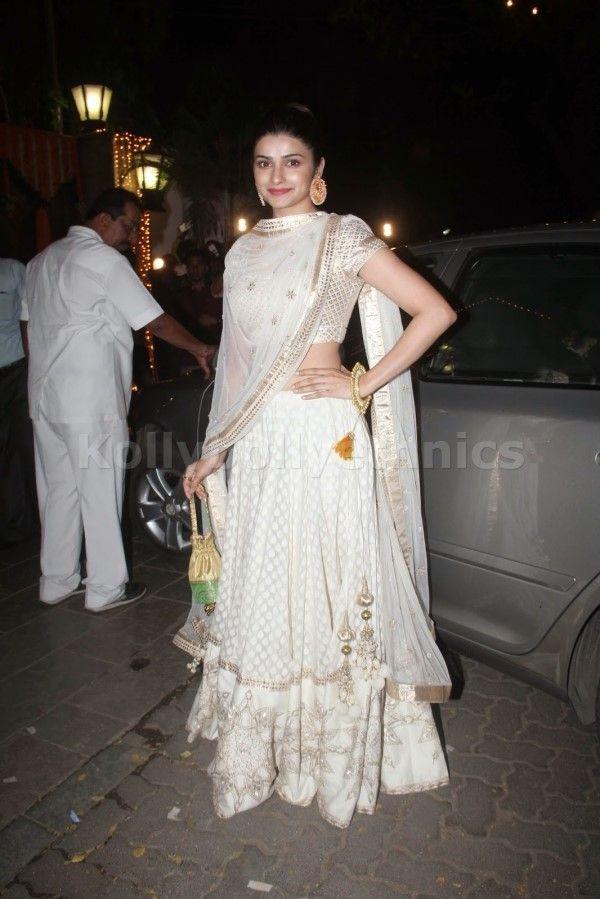 Bollywood Actress Prachi desai Georgette lehenga in white color