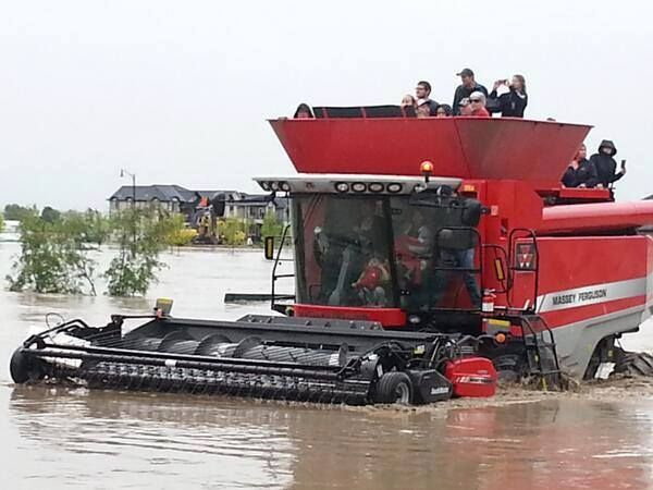 Being rescued by combine in the flooding in Southern Alberta