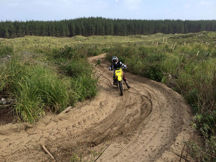 Noah on a sandtrack in the Woodhill Forest
