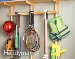 Oh, this is great!  DIY sports gear rack for the garage.  Specialty gear hooks and bat racks are expensive, and while vinyl-covered utility hooks only cost a few dollars, they only hold single items. Each of these inexpensive sports gear hangers will hold several bats and racquets.  Each set of hangers is made from a pair of lag screws covered with CPVC sleeves to protect the gear. Customize the hangers by spacing them closer or wider apart depending on what you want to hang.