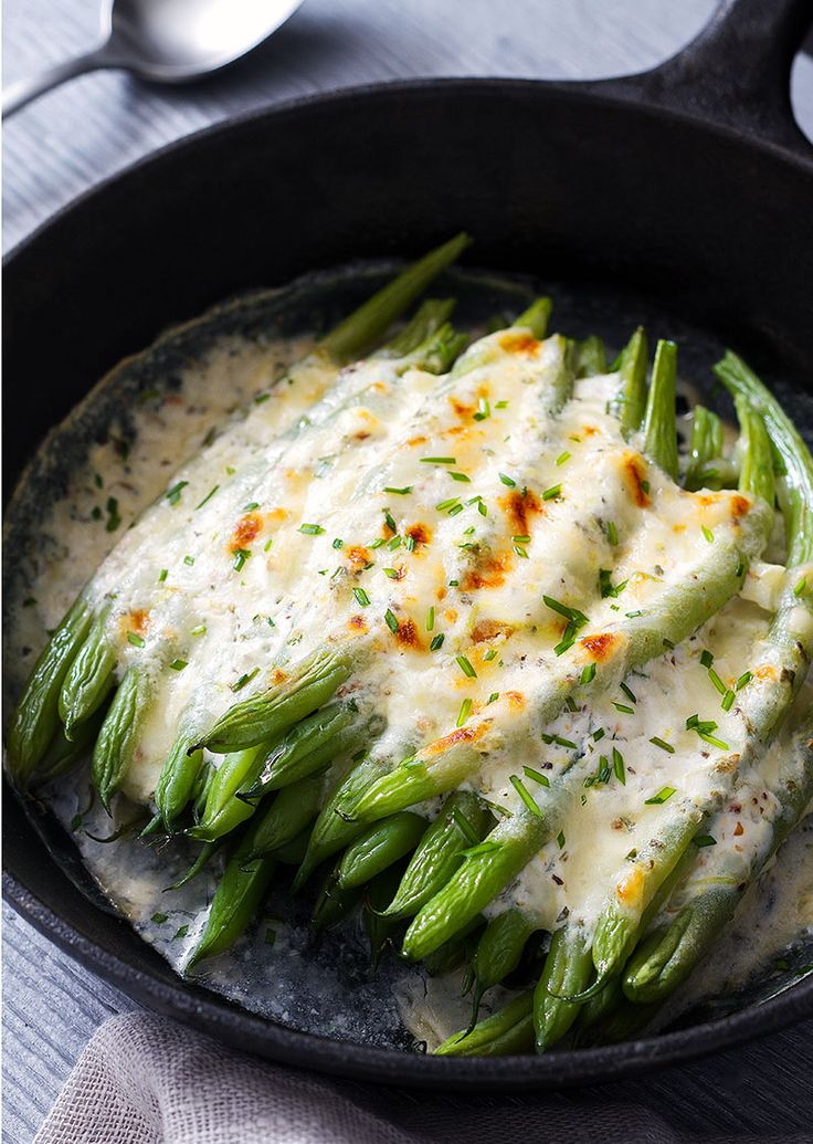 Simply roast green beans with a mix of cream, garlic and herbs, top with cheese…