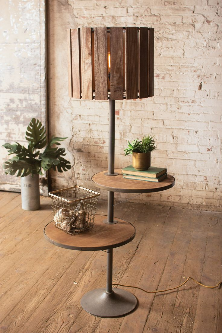 """Floor lamp with rotating shelves. 18"""" diameter x 64"""" tall. Different lamp shade but I like the wood tables."""